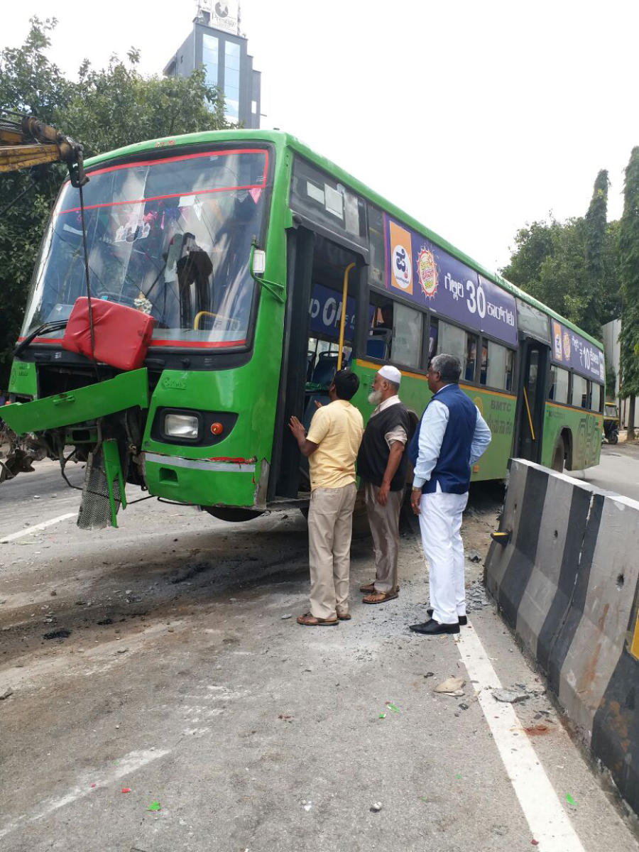 BMTC bus after the driver lost control and rammed the vehicle into the divider on the busy Kasturba Road on Tuesday morning. DH Photo
