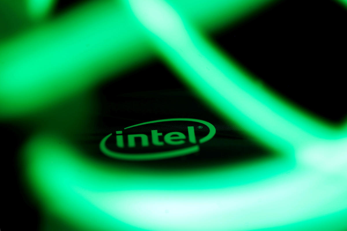 Intel logo is seen behind LED lights in this illustration. REUTERS
