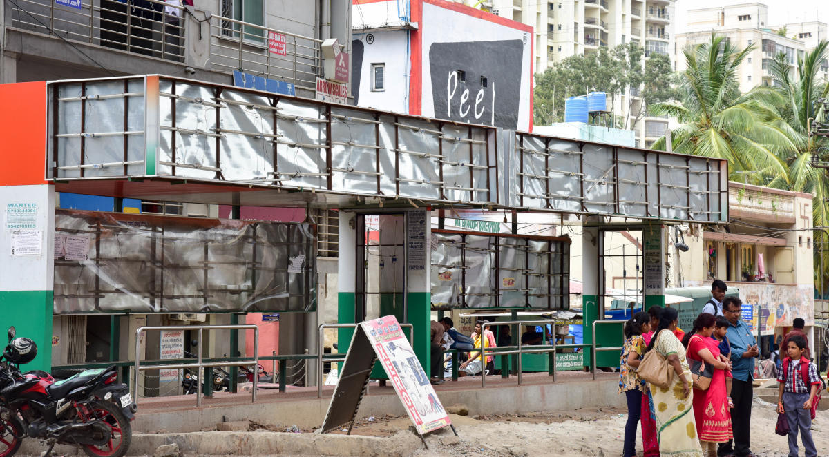The display board, which was removed during the elections in May, remains bare to this day at a bus stop in the city. DH Photo/B H Shivakumar