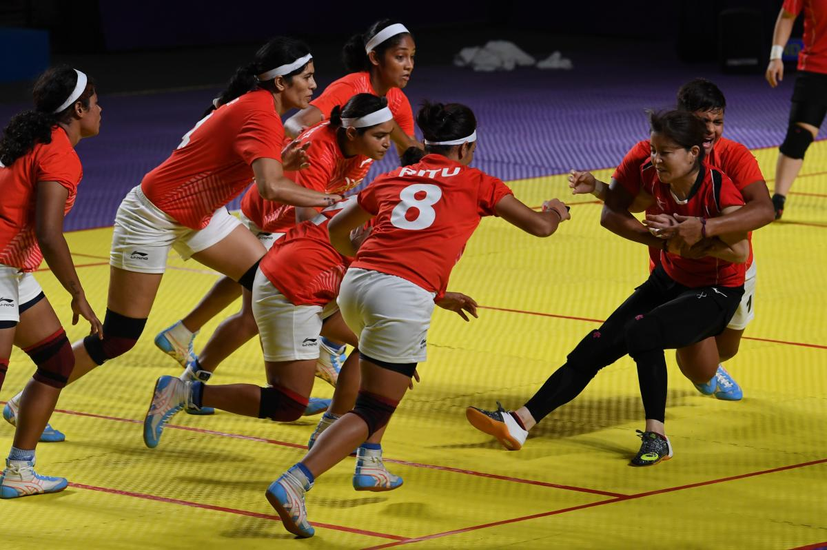 India's players (in white shorts) tackle a Japan player (in black shorts) during the women's team Group A match between India and Japan at the 2018 Asian Games in Jakarta. (AFP Photo)