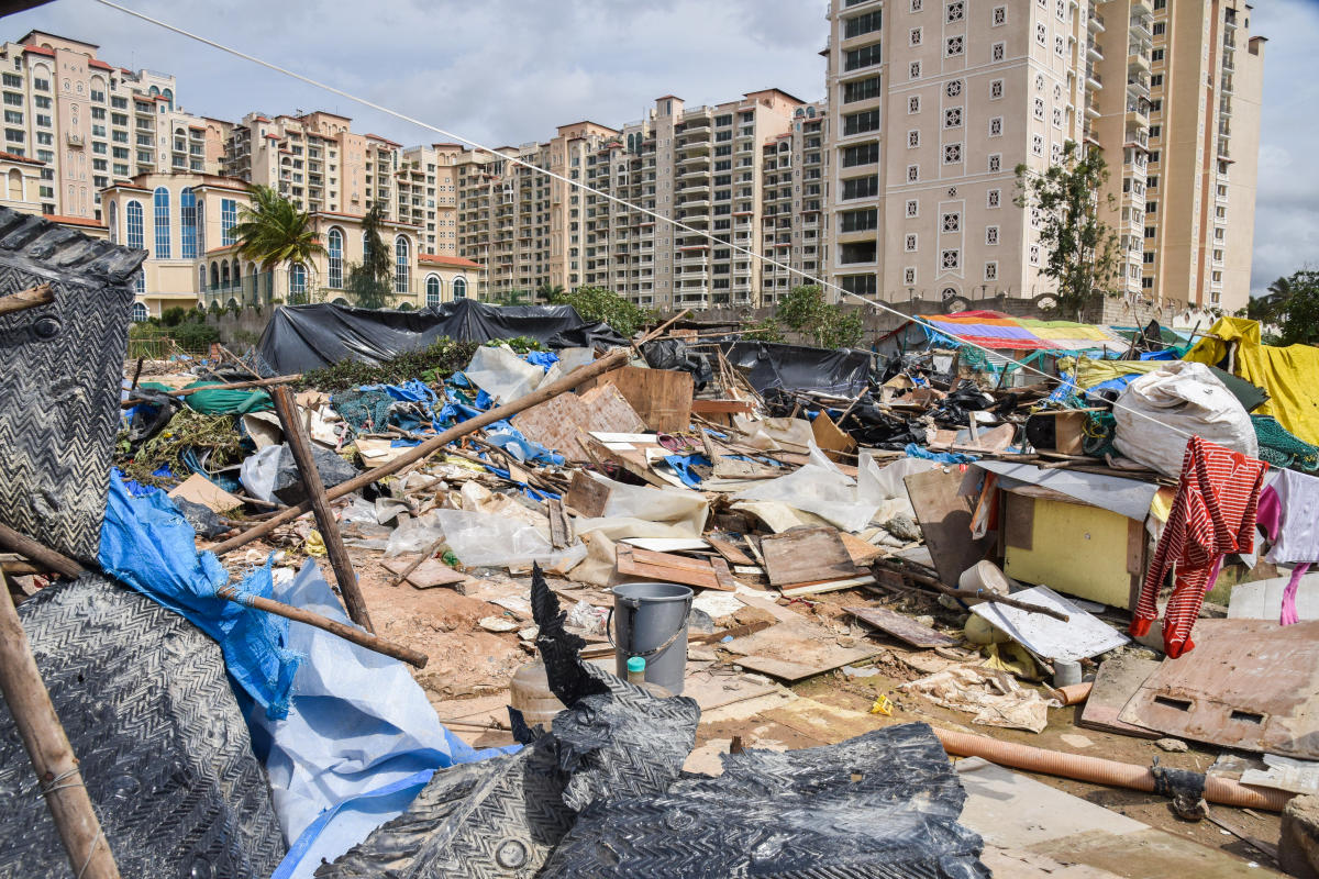 The tin-roofed sheds razed to the ground near Sakra World Hospital in Bellandur on Sunday. DH PHOTO/S K Dinesh