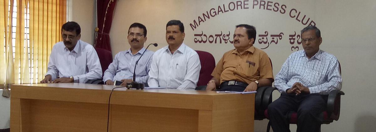 Senior Superintendent of Posts Mangaluru Division Diwakara speaks to reporters in Mangaluru on Wednesday.