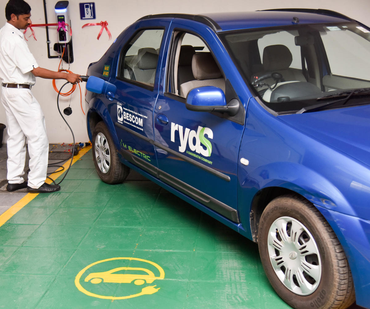 REDUCING CARBON FOOTPRINTS: An electric charging station at the head office of Karntaka Energy Regulatory Commission office in Bengaluru. DH File Photo