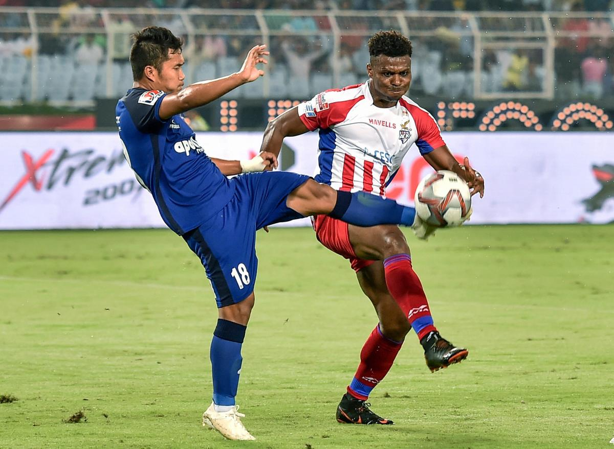 KEEN TUSSLE: ATK player Kalu Uche (9) vies for the ball with Jerry Lalrinzuala (18) of Chennaiyin FC. PTI
