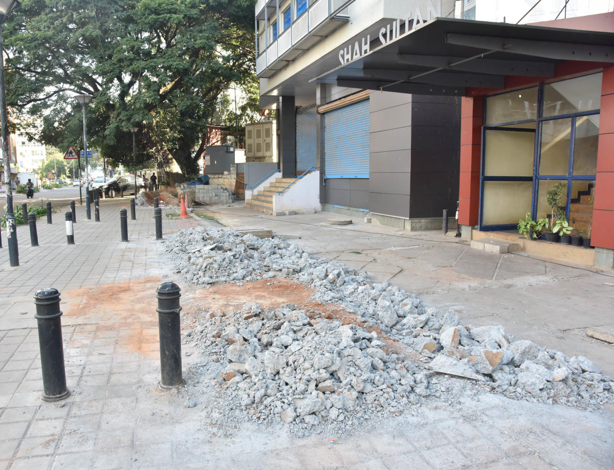 The damaged TenderSURE footpath in front of Shah Sultan complex on Cunningham Road. DH Photo