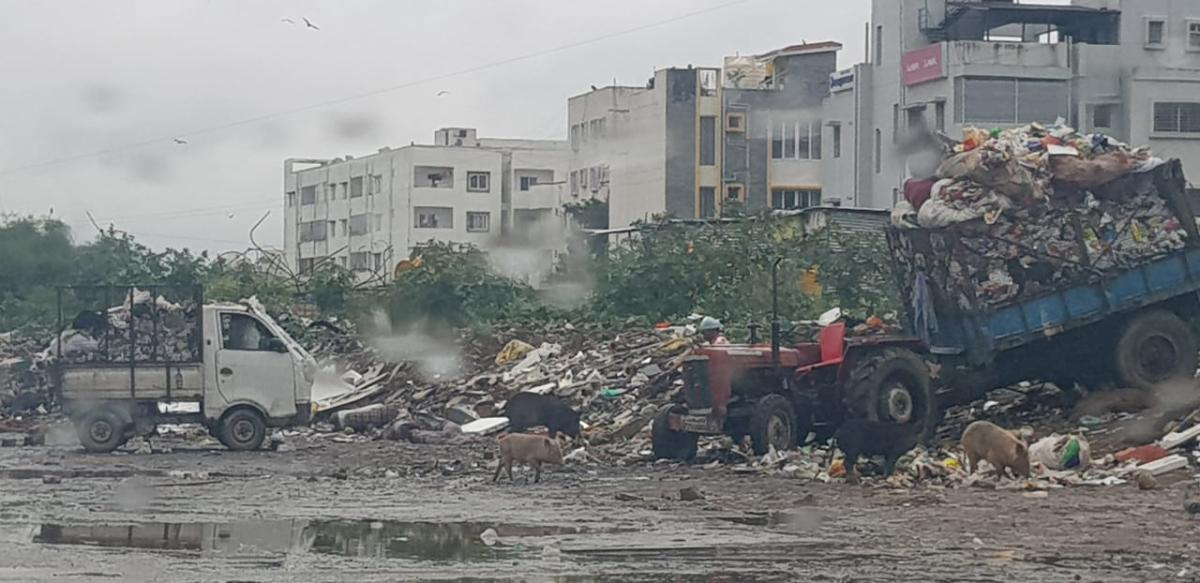 BBMP staff dumping garbage at a vacant plot in Ranka Colony, off Bannerghatta Road.