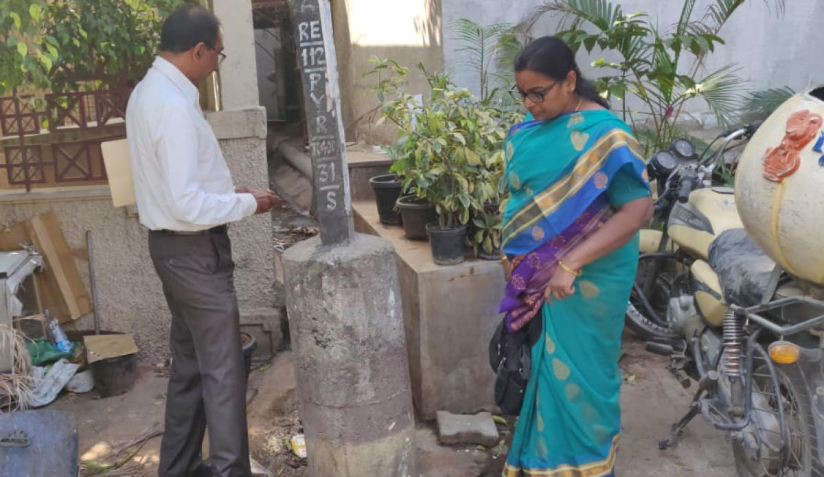 BBMP officials inspect two restaurants that have violated SWM rules and connected sewage lines to the BWSSB main drain at Domlur on Monday.