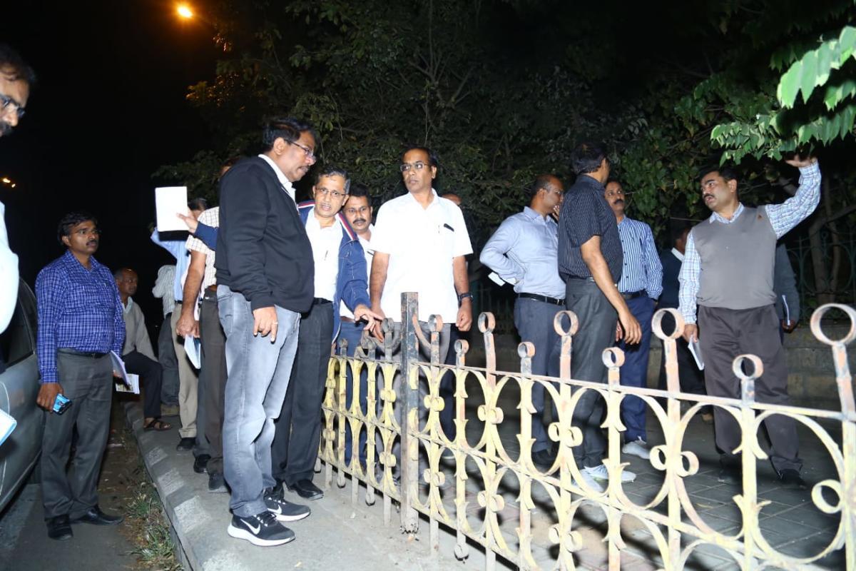 BBMP Commissioner N Manjunath Prasad inspects a footpath on Monday night.