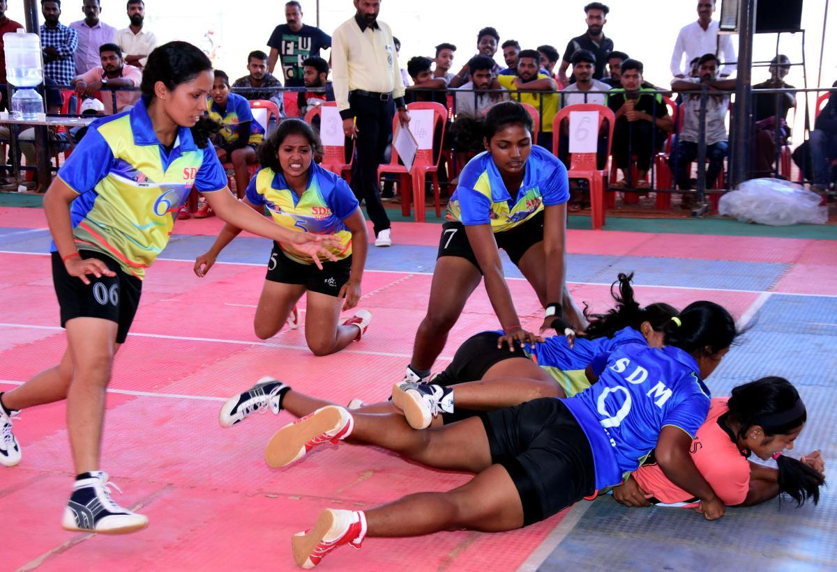 Kabaddi players in action at the district-level championship at Karavali Utsav grounds in Mangaluru.