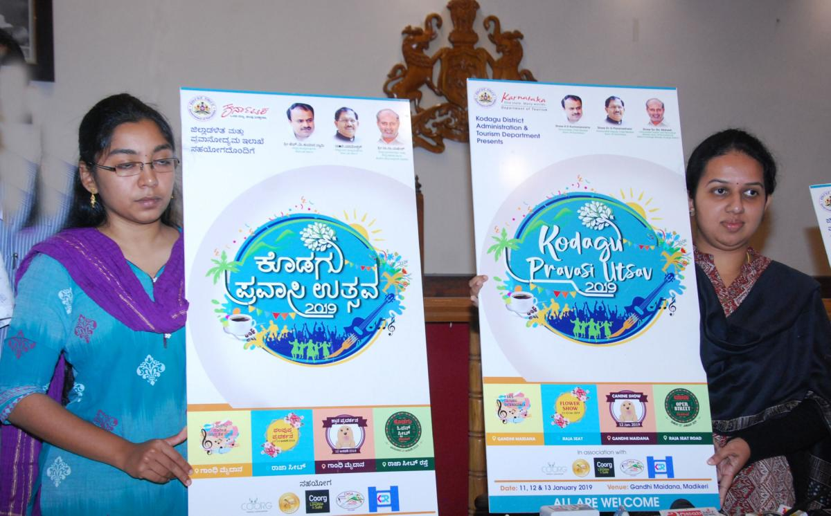 Kodagu Deputy Commissioner P I Sreevidya (right) and Zilla Panchayat CEO Lakshmi Priya release the logo of Kodagu Pravasi Utsav in Madikeri on Tuesday.