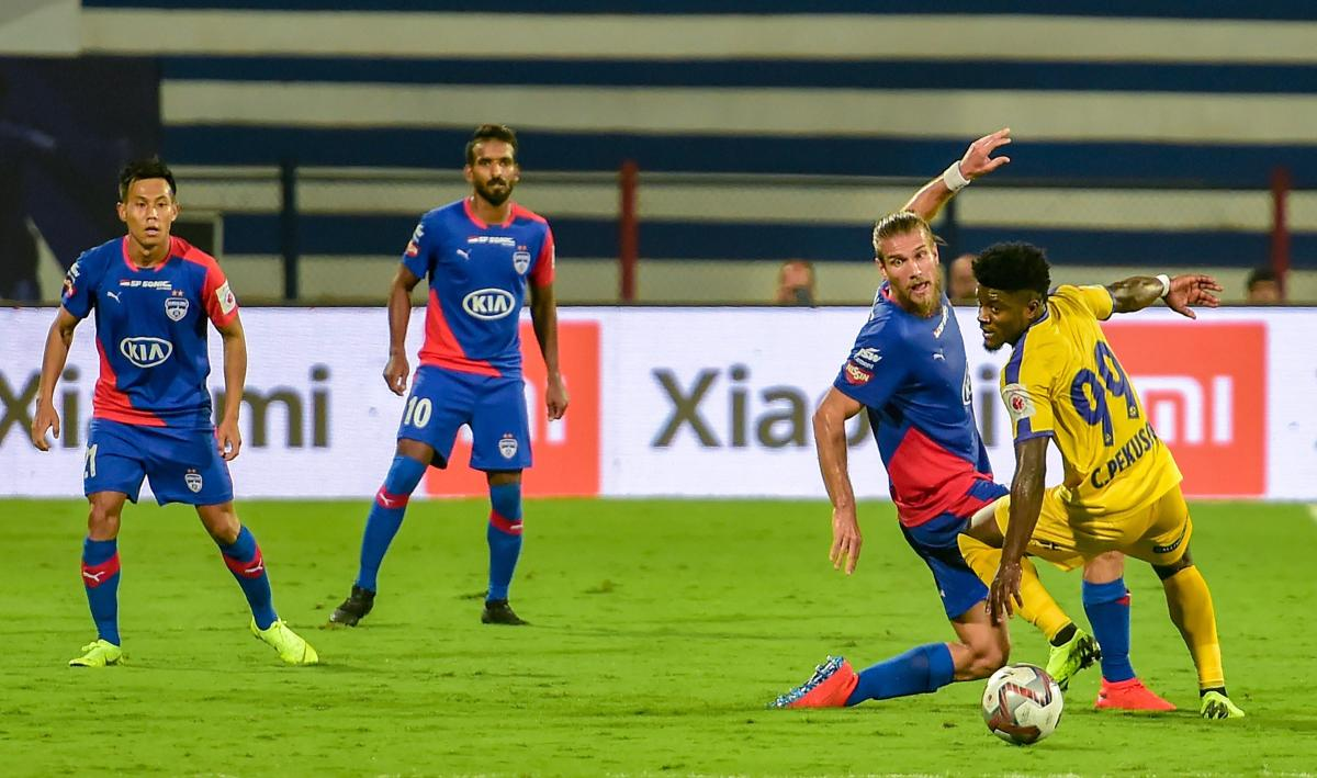 Bengaluru FC's Erik Paartalu and Kerala Blasters' Courage Pekuson vie for the ball during their ISL match. PTI file photo.
