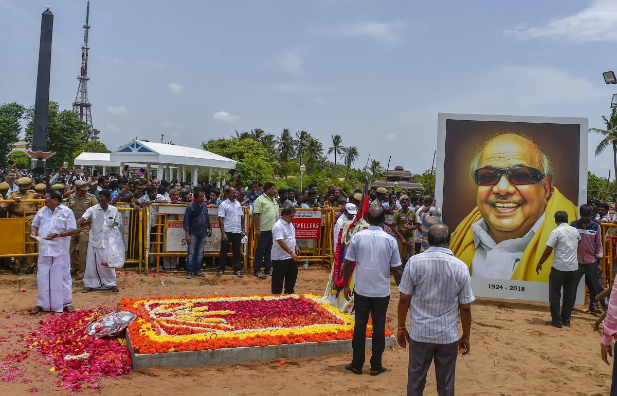 Workers decorate the memorial of late DMK president M Karunanidhi before opening for the public to pay their last respects at Anna Memorial on Marina beach, in Chennai. PTI photo
