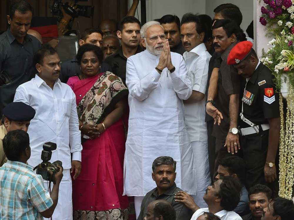 Prime Minister Narendra Modi expresses his condolence to DMK supporters and worker on the demise of their Party chief M Karunanidhi at Rajaji Hall, in Chennai on Wednesday. PTI Photo