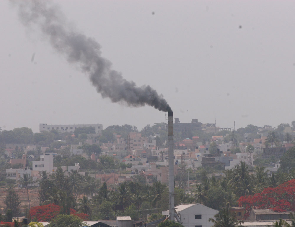 While we're intolerant of cigarette smoke, we're shockingly accepting of the toxic air in our cities. (DH File Photo)