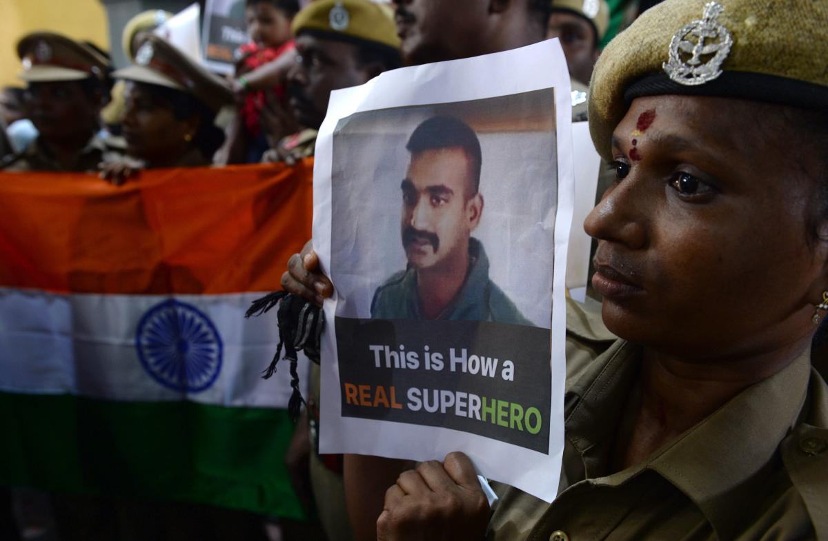 Indian security forces pose with the national flag and pictures of Indian Air Force pilot Abhinandan Varthaman during an event to pray for his return, at Kalikambal temple in Chennai. AFP photo