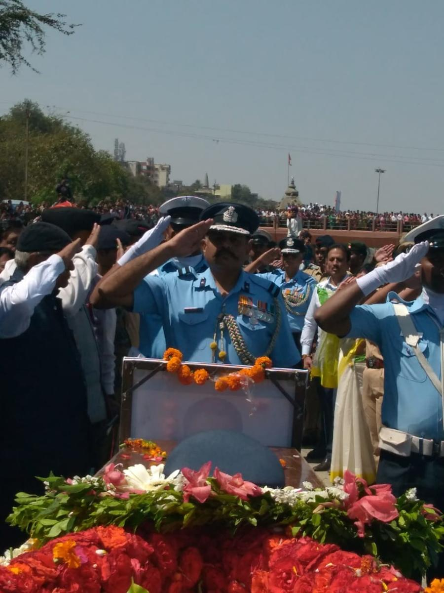 Officials salute IAF pilot Sqn Ldr Ninad Mandavgane during his funeral ceremony in Nashik.