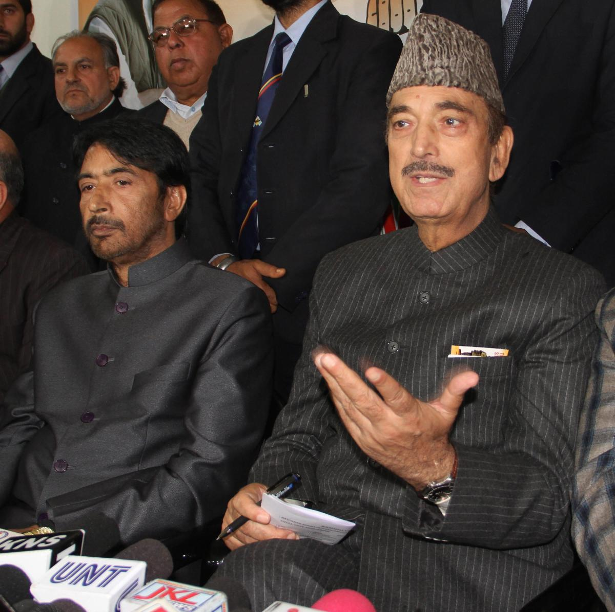 Senior Congress leader Ghulam Nabi Azad and JKPCC President GA Mir at a press conference, in Jammu on Saturday. (PTI Photo)