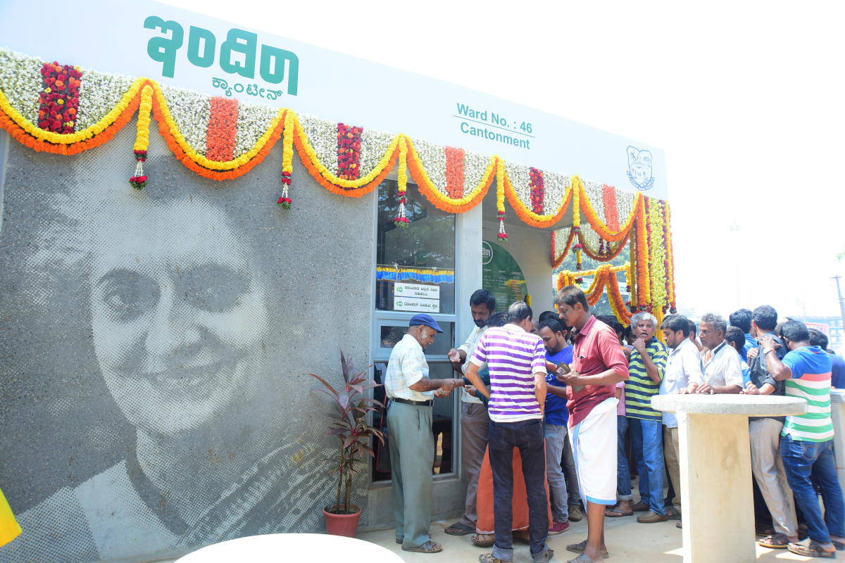 A file photo of people buying food coupon in front of Indira canteen near Service Bus Stand in Mangaluru.