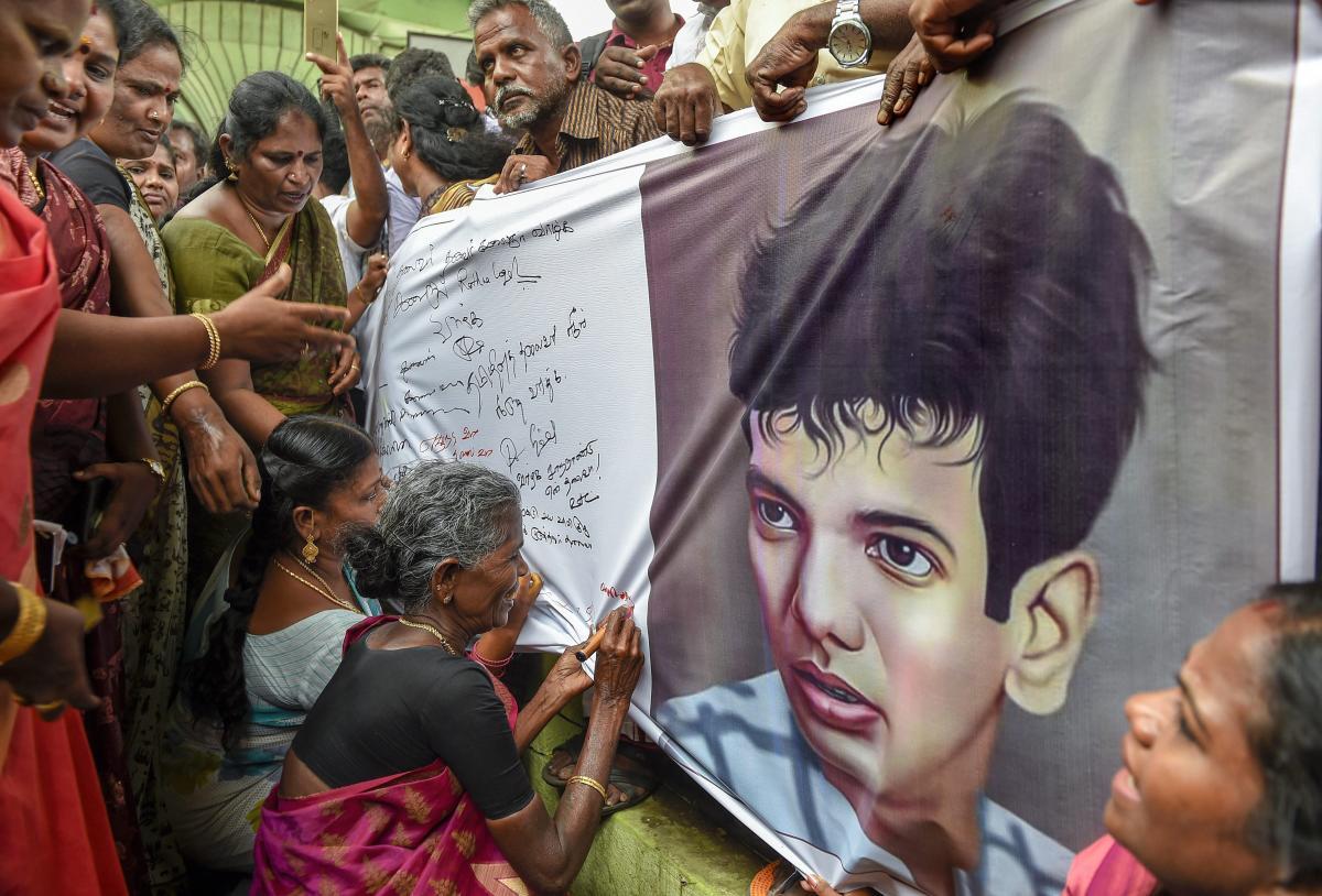 Dravida Munnetra Kazhagam (DMK) supporters gather outside the hospital, where DMK chief M Karunanidhi is being treated, in Chennai. (PTI Photo)