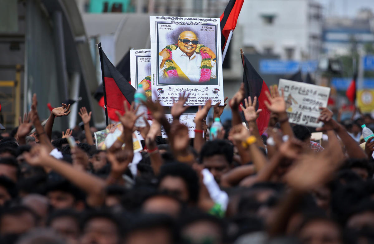 Supporters hold the portrait of the Indian Tamil leader Muthuvel Karunanidhi during his funeral in Chennai, India August 8, 2018. REUTERS/P.Ravikumar