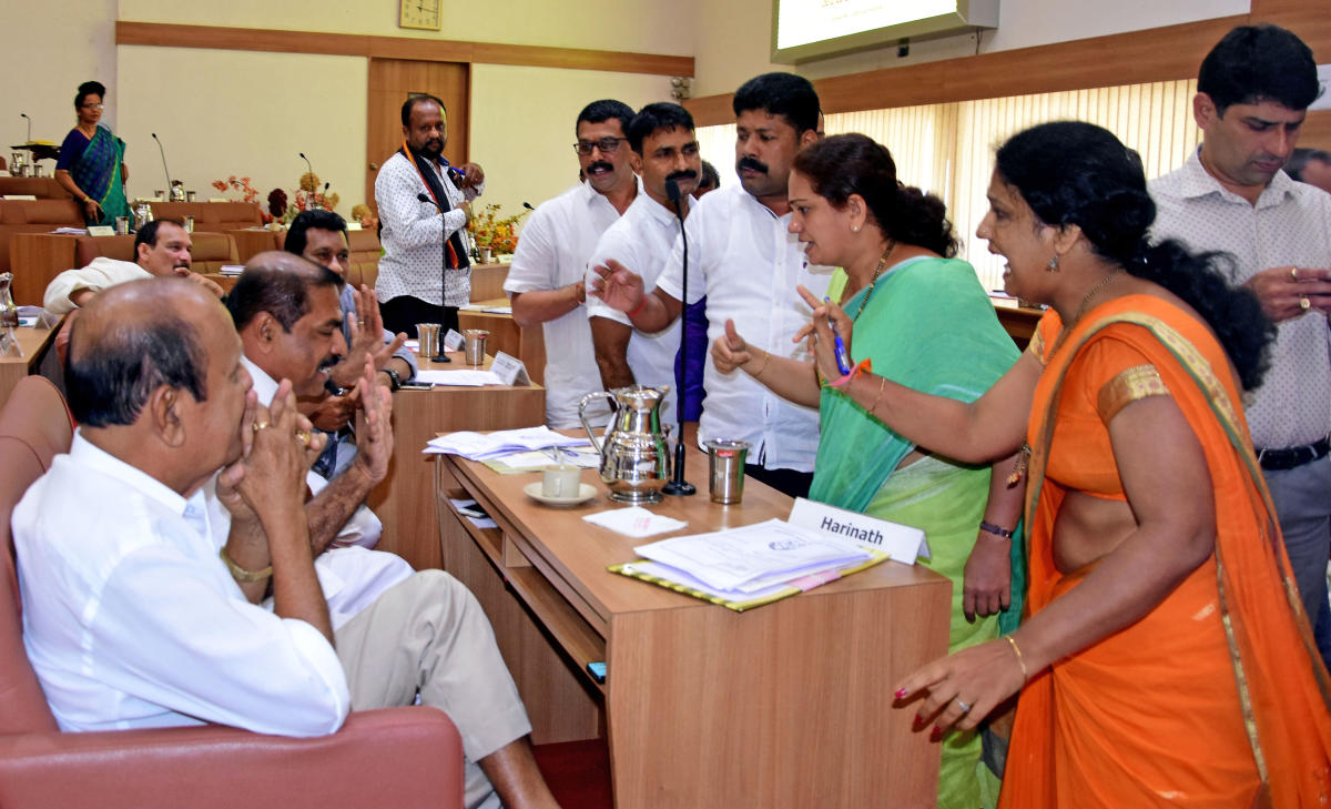 Opposition members take Shashidhar Hegde, Chief Whip of the Mangaluru City Corporation Council, to task during the monthly council meeting in Mangaluru on Wednesday.