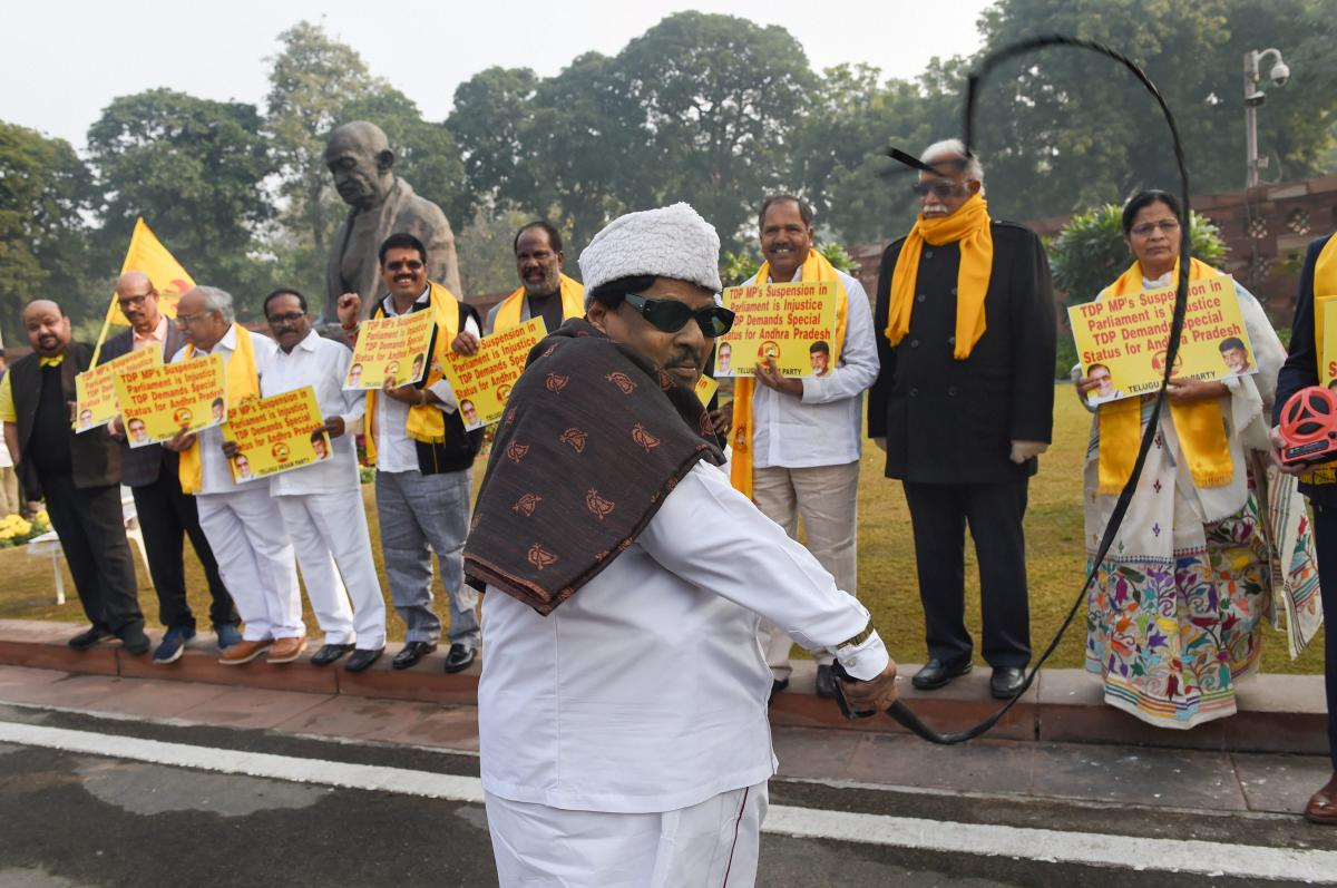 TDP MP Naramalli Sivaprasad with party MPs stage a protest demanding for special package for Andhra Pradesh, during the Winter Session of Parliament, in New Delhi, on Monday. PTI