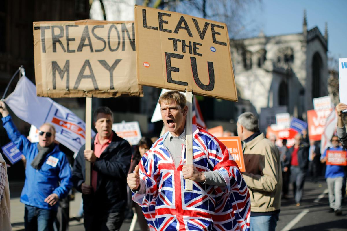 Pro-Brexit activists march outside the Houses of Parliament in central London. Lawmakers who voted down Prime Minister Theresa May's European Union withdrawal deal in January have outlined demands for a revised treaty to ensure their support. (AFP Photo)