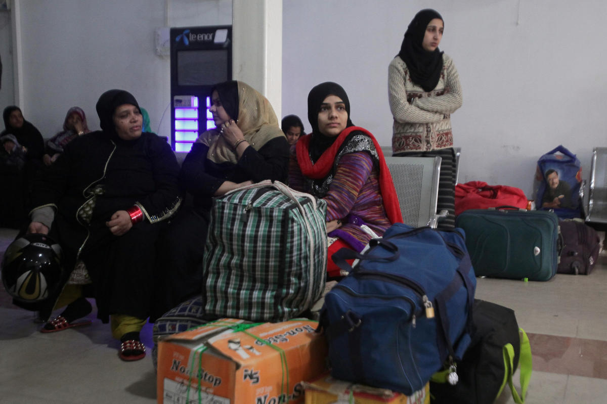 Passengers from India with their belongings wait for Samjhauta Express train which is temporarily suspended after Pakistan shot down two Indian military aircrafts, according to Pakistani officials, at the railway station in Lahore, Pakistan February 28, 2
