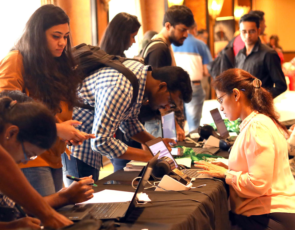 Students registering for the Ireland International Education Fair on Saturday. DH PHOTO/Sudheesha K G
