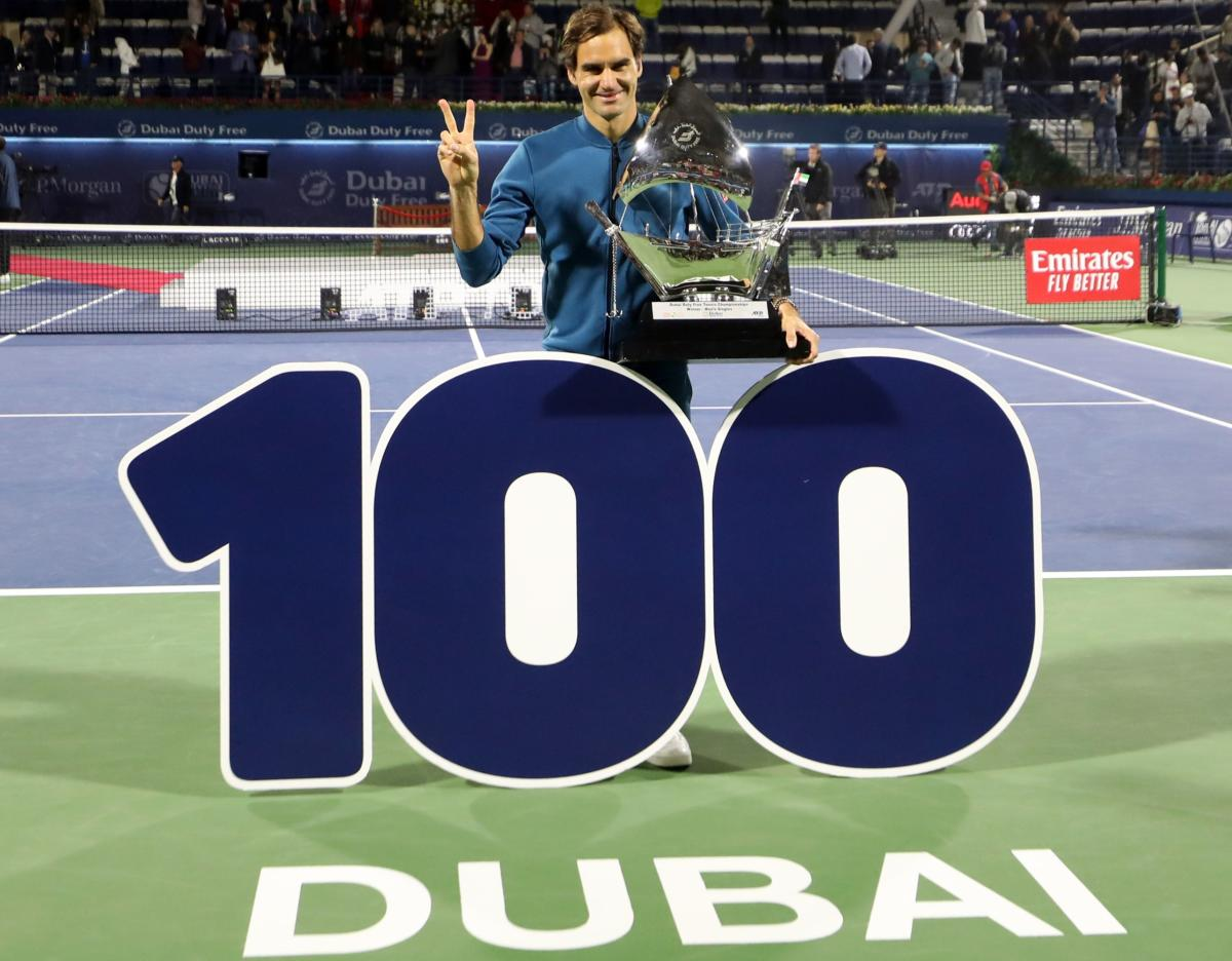 ANOTHER PEAK: Switzerland's Roger Federer celebrates with the Dubai Tennis Championship trophy after defeating Greece's Stefanos Tsitsipas in the final. AFP