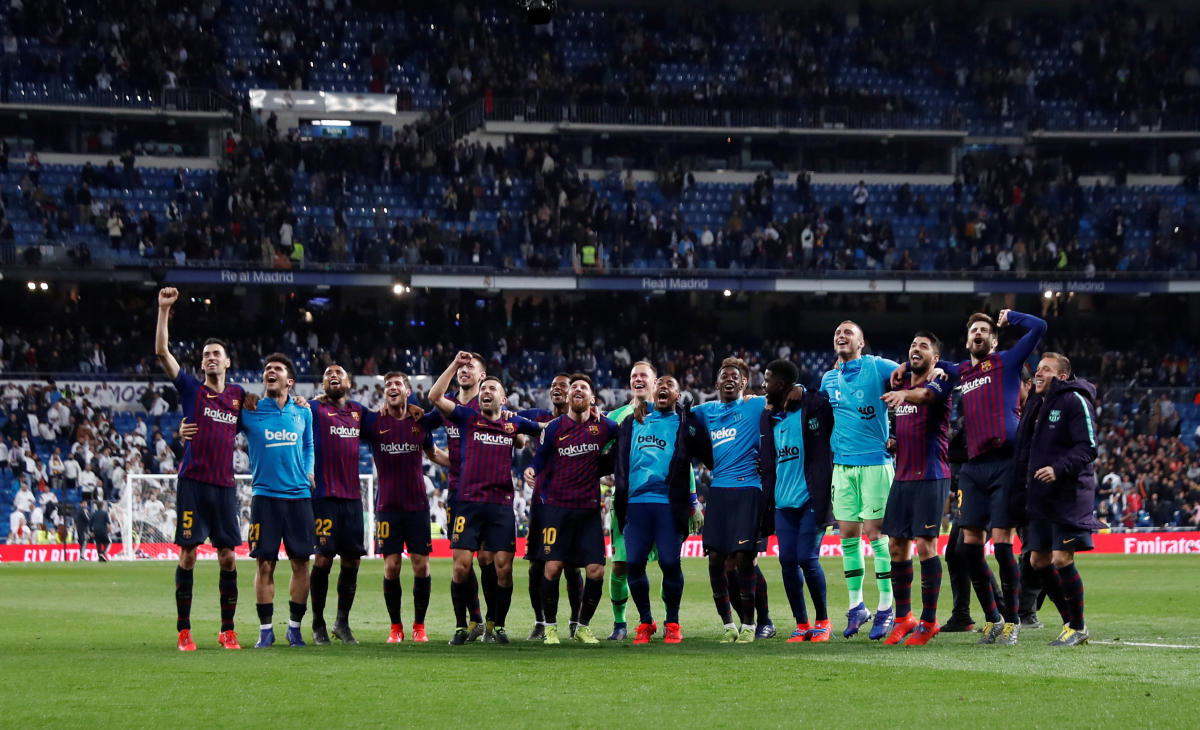 After knocking Real out of the Copa del Rey on Wednesday, Barca returned to the Santiago Bernabeu for a 1-0 victory that surely eliminates their greatest rivals from the title race too. (Reuters Photo)