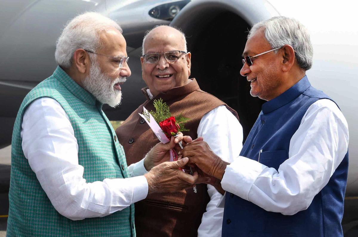 Prime Minister Narendra Modi being greet by Bihar CM Nitish Kumar as Governor Lalji Tandon looks on his arrival at Jai Prakash Narayan airport in Patna. PTI