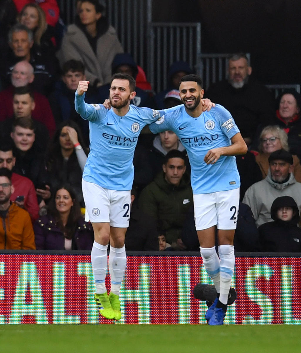 ON TARGET: Manchester City's Riyad Mahrez (right) celebrates after scoring against Bournemouth. REUTERS