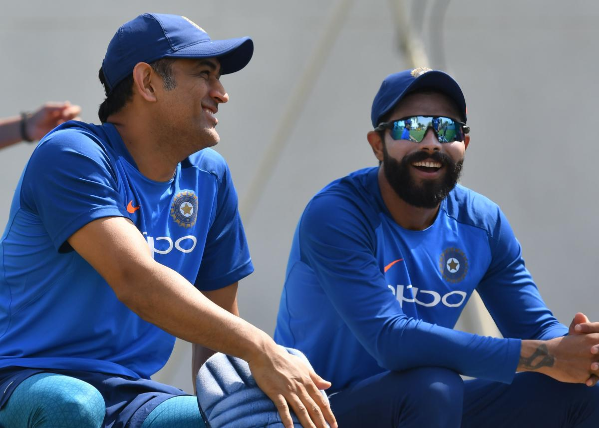IN RELAXING MOOD: Mahendra Singh Dhoni (left) and Ravindra Jadeja share a light moment during during India's training session at the VCA Stadium in Nagpur on Monday. AFP