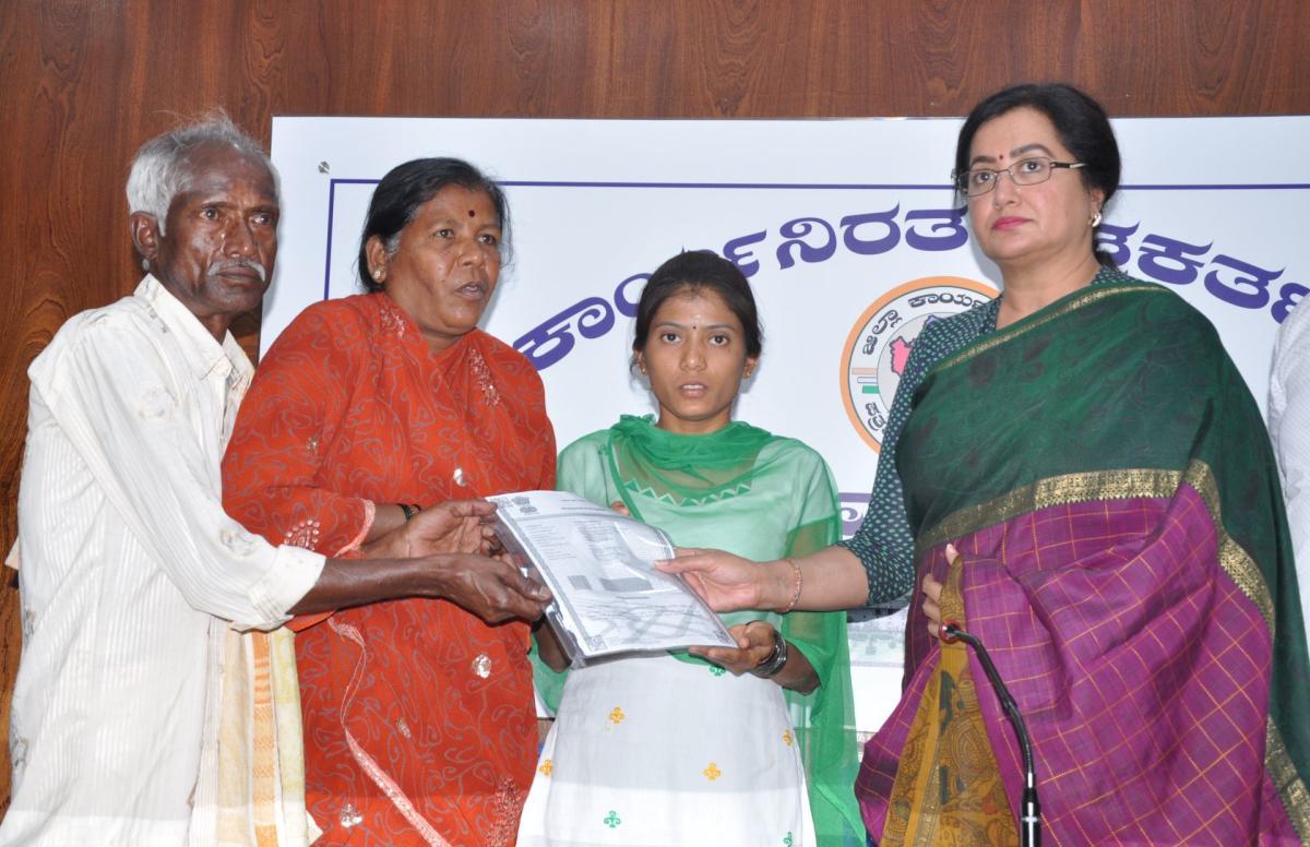 Sumalatha presents gift deed transferring 20 guntas of land to Kalavathi, wife, and parents of CRPF jawan H Guru, who was martyred in Pulwama terror attack, in Mandya, on Monday.
