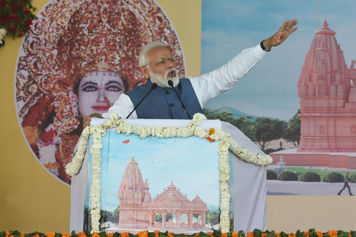Indian Prime Minister Narendra Modi speaks during the inauguration of the 'Annapurnadham', a Panch Tatva temple, in Adalaj, some 30 kms from Ahmedabad on Tuesday. (AFP Photo)