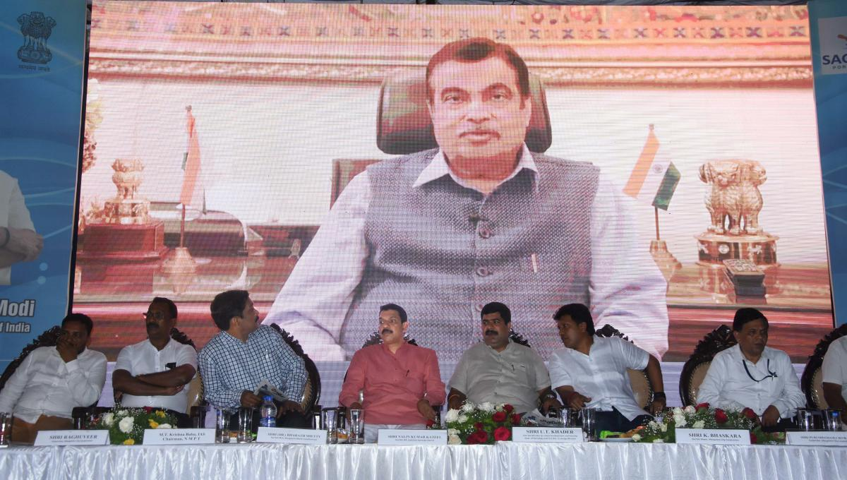 Union Minister for Road Transport and Highways, Shipping and Water Resources Nitin Gadkari addresses the gathering via a video conference from New Delhi, after laying the foundation for the fishing harbour project at Kulai and various road development pro