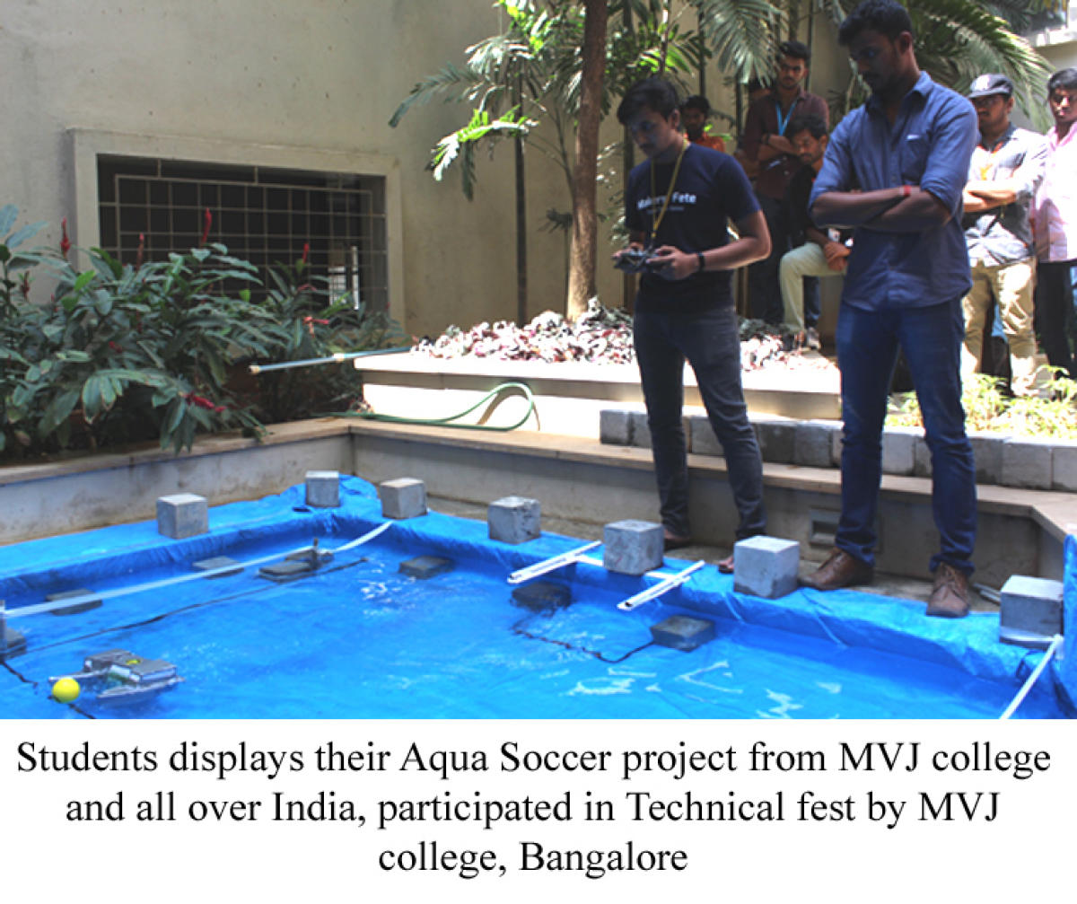 Students from MVJ College of Engineering display their aqua soccer project.