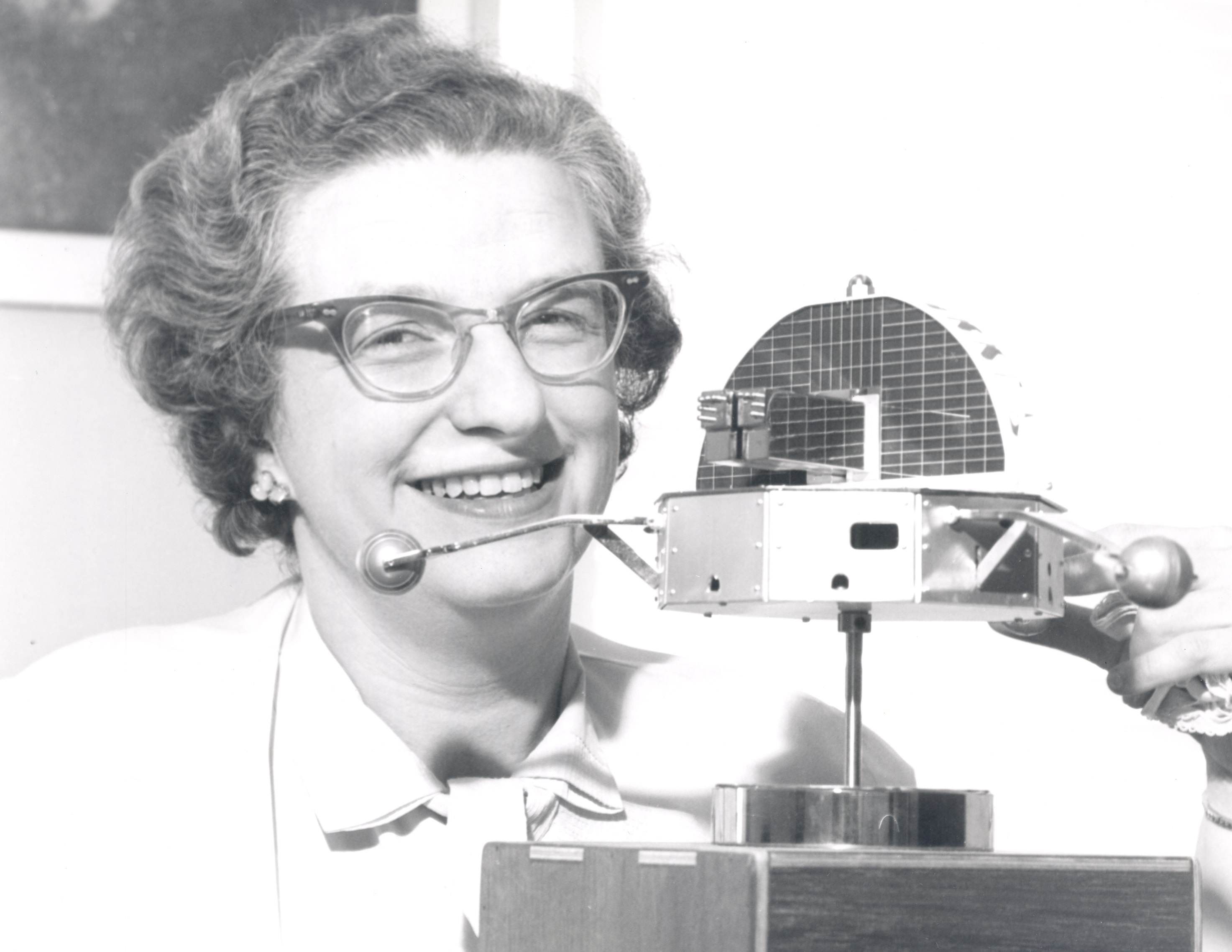 Dr Nancy Grace Roman with a model of the Orbiting Solar Observatory. Wikimedia Commons