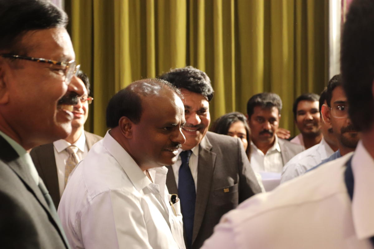 Chief Minister H.D. Kumaraswamy speaks to delegates during a summit held by the Confederation of Indian Industry (CII) at the Taj West End Hotel in Bengaluru on March 6, 2019. At the Chief Minister's left is Dr. N. Muthukumar, Chairmen of the CII.