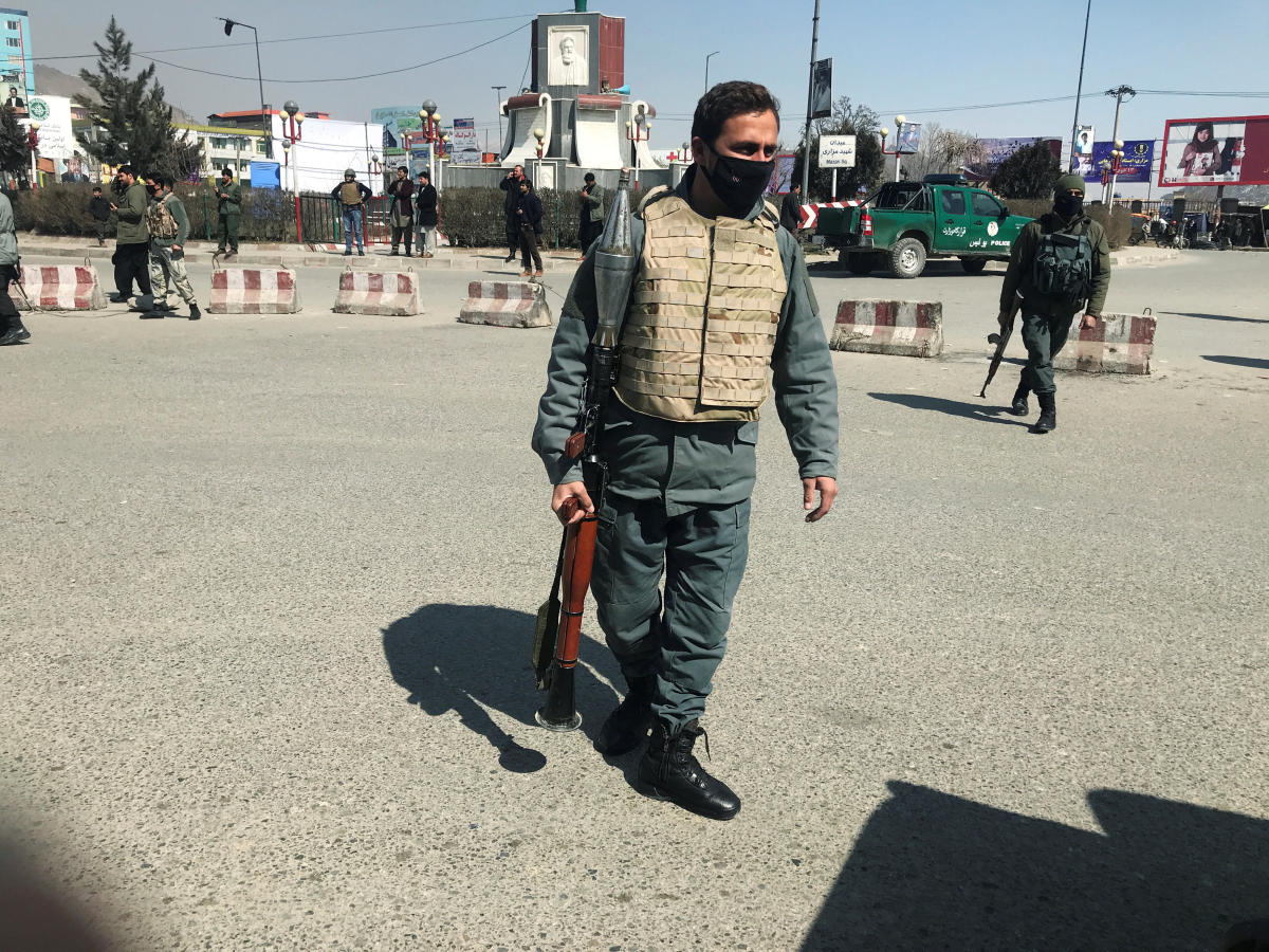 A policeman keeps watch near the site of an attack in Kabul, Afghanistan. (Reuters Photo)