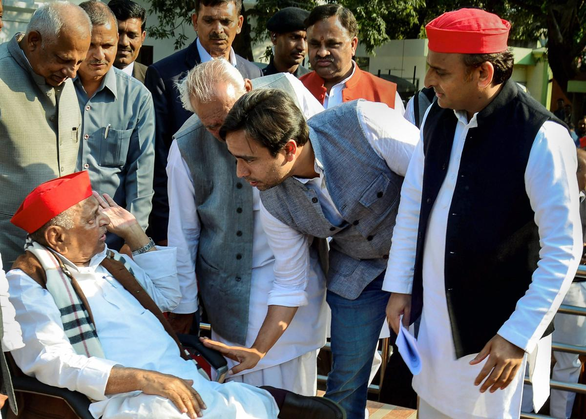 Samajwadi Party founder Mulayam Singh Yadav interacts with RLD vice-president Jayant Chaudhary as Samajwadi Party President Akhilesh Yadav looks on, before a press conference in Lucknow, Tuesday, March 5, 2019. (PTI Photo)