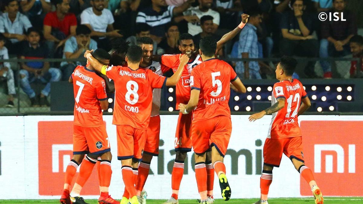 FC Goa players celebrate their win over Mumbai City FC in Mumbai on Saturday. ISL MEDIA