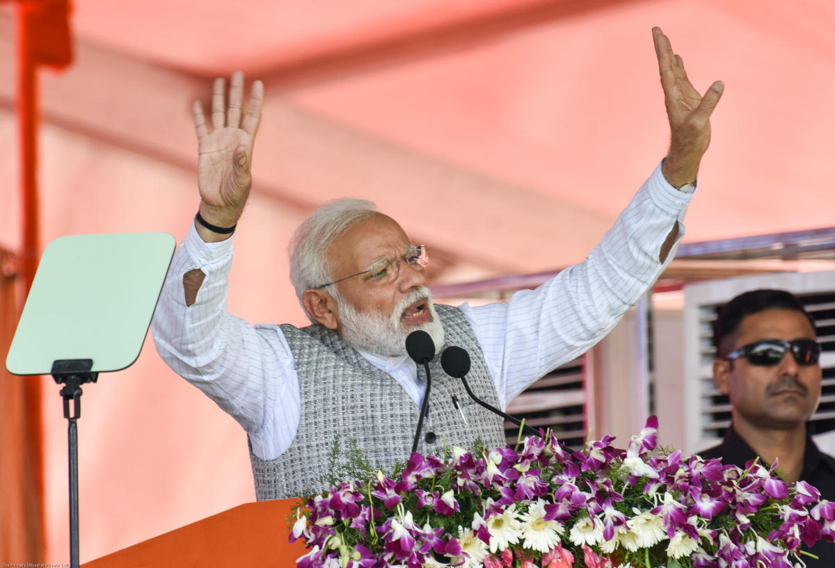 Prime Minister Narendra Modi gestures during his speech at a public rally for upcoming loksabha elections at NV Ground in Kalaburagi. - Photo/ Prashanth HG
