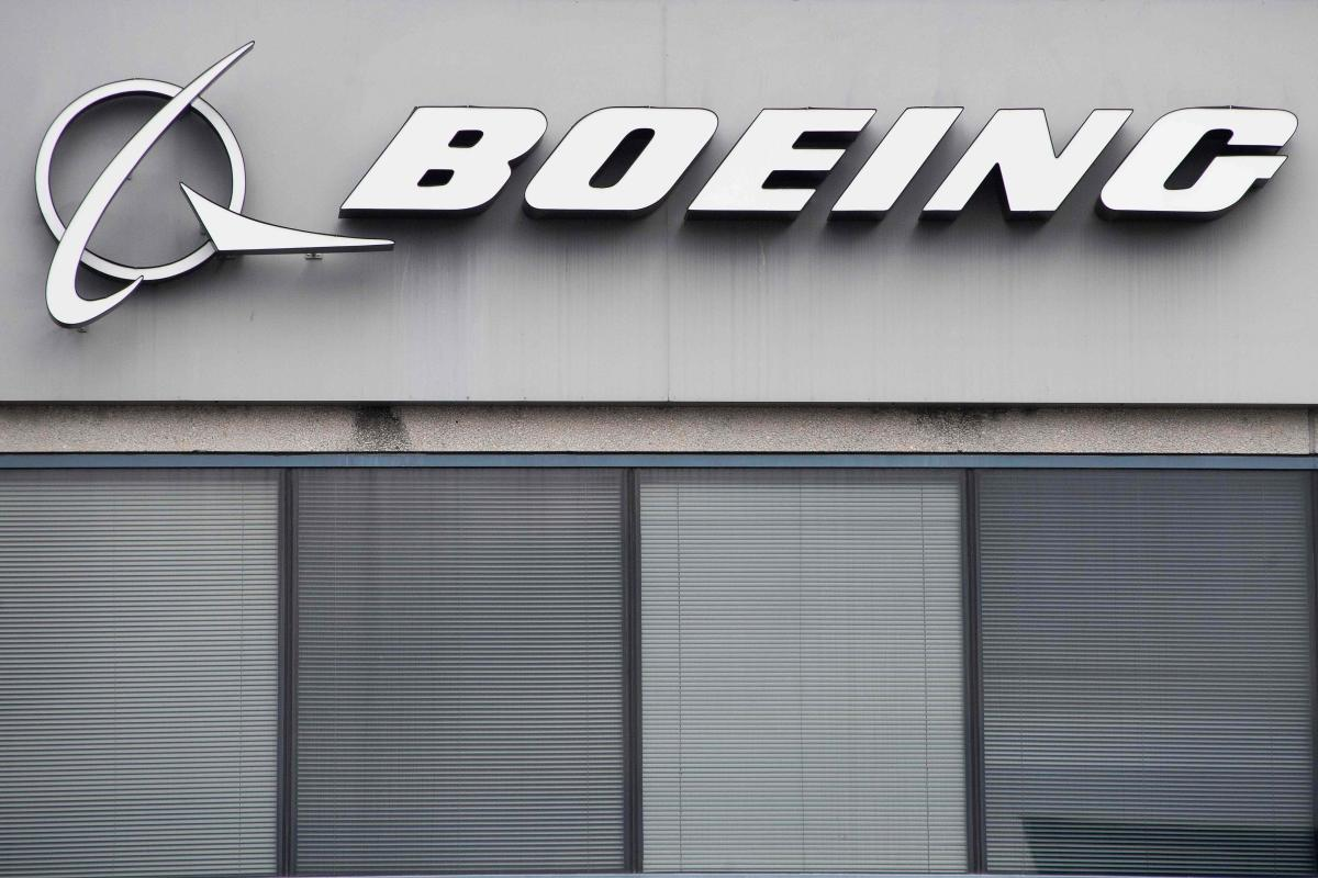 The Boeing Company logo is seen on a building in Annapolis Junction, Maryland, on March 11, 2019. Tumbling shares in US aviation giant Boeing on Monday tore a hole in the Dow Jones Industrial Average, sending the benchmark index into the red for a sixth d