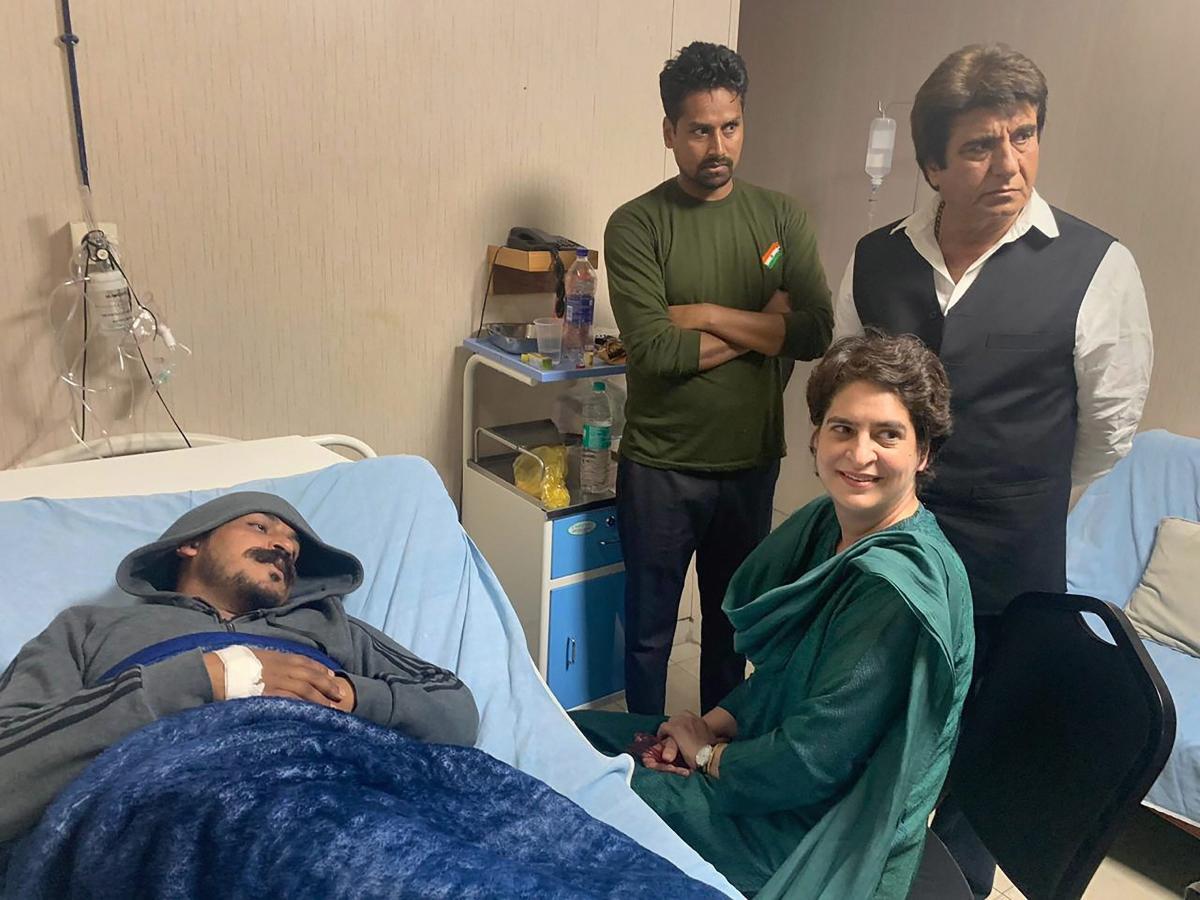 Congress general secretary Priyanka Gandhi Vadra visits Bhim Army chief Chandrashekhar Azad at a hospital, in Meerut on Wednesday. PTI