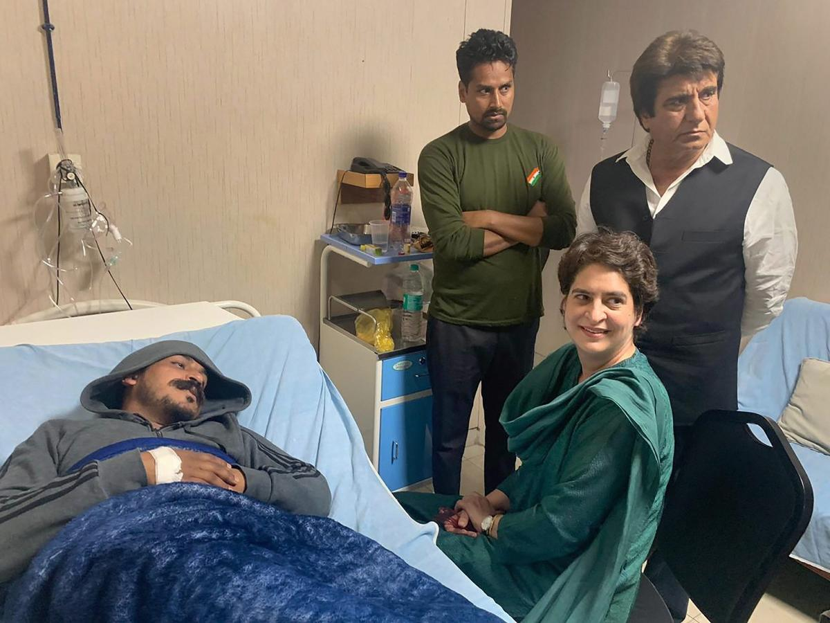 Congress General Secretary Priyanka Gandhi Vadra visits Bhim Army chief Chandrashekhar Azad at a hospital, in Meerut, Wednesday, March 13, 2019. Azad was detained while leading a procession that included cars and motorcycles, but was shifted to the hospital when he took ill. (PTI Photo)