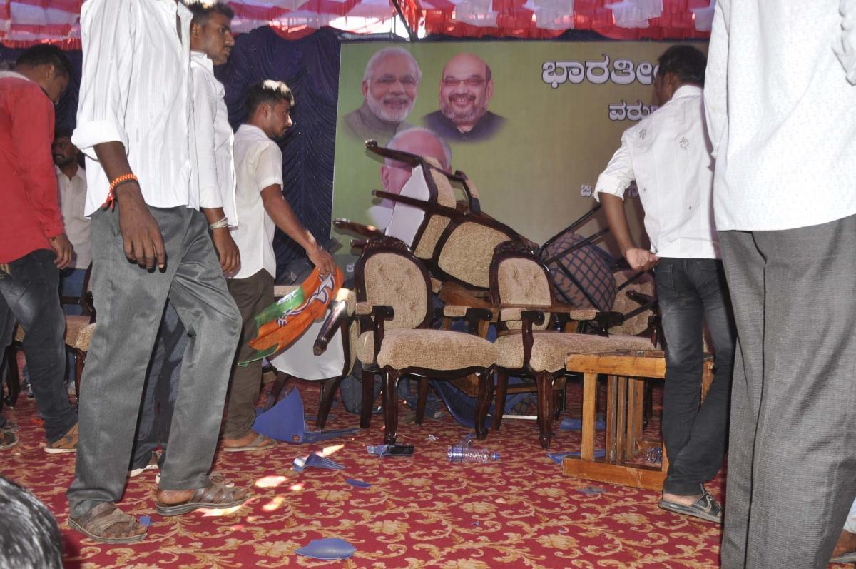 BJP workers ransack the dais as a mark of protest in Nanjangud, Mysuru, district, on Monday.