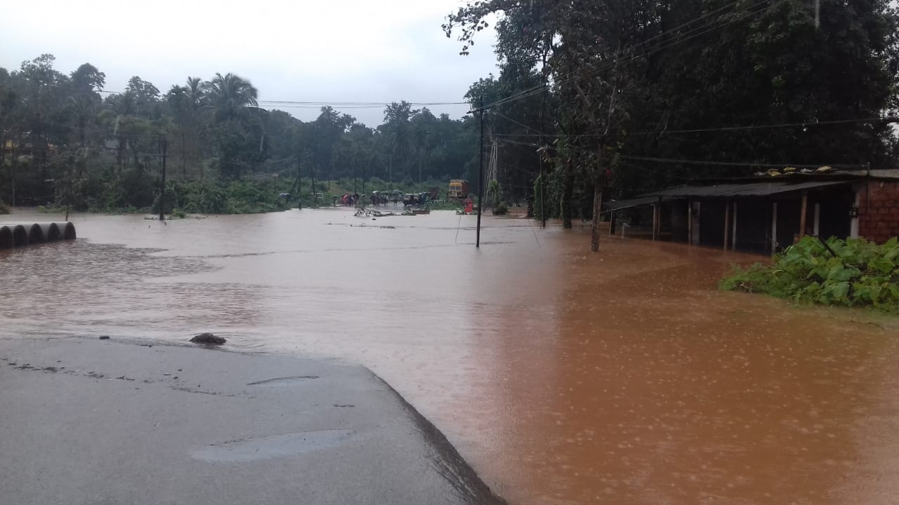 Water from Gundya river breaches National Highway-75 that connects Bengaluru and Mangaluru at Udane. (DH Photo)