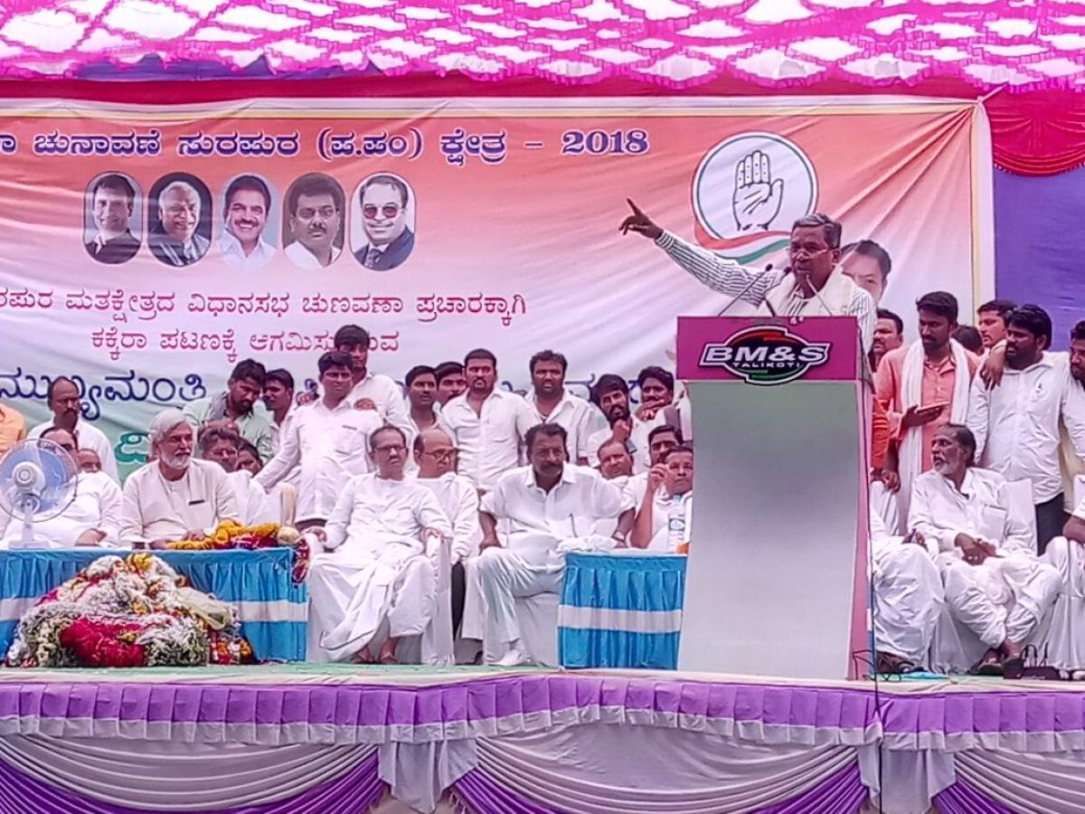 Chief Minister Siddaramaiah addresses a rally at Kakkera village in Yadgir district on Monday. DH Photo